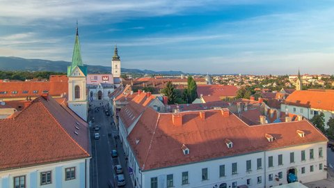 Church of St. Mark timelapse and parliament building Zagreb, Croatia. Top view from Kula Lotrscak tower before sunset