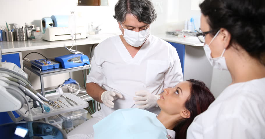 Dentist Practitioner Man Hold Check Stock Footage Video (100