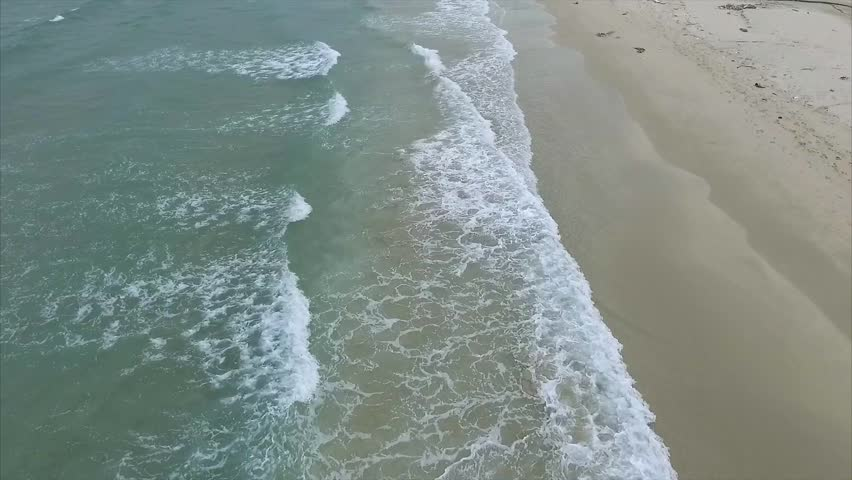Slow Motion Aerial Video of the Wild Sandy Beach With Clear Water, Waves and Foam, Vietnam | Shutterstock HD Video #20460907