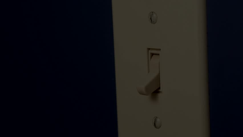 Switching ON and OFF a wall switch. Blue wall. | Shutterstock HD Video #20506657