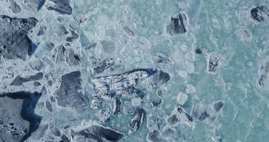 Aerial view of a glacier huge pieces of frozen ice and rock, top view   | Shutterstock HD Video #20539057