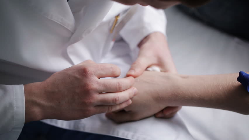 Doctor's Hand With catheter Inserted In Patient's Hand | Shutterstock HD Video #20552023
