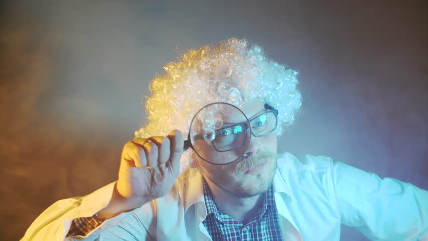 funny scientist, with a magnifying glass
