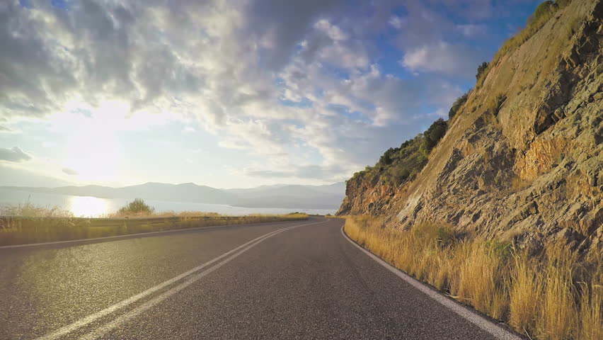 POV car travel vehicle driving coastal local road mediterranean rocky coastline sky sunny clouds point of view | Shutterstock HD Video #20594923