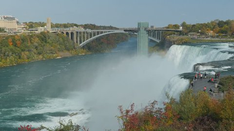 NIAGARA FALLS, NY - OCTOBER 18: Tourists view the American Falls on the Niagara River from Luna Island in Niagara Falls State Park on October 18, 2016 in Niagara Falls, New York.