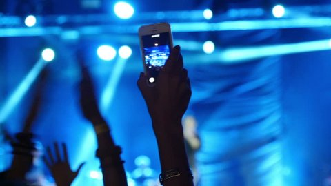 Nikolaev, Ukraine - September 16, 2016: fan record video on smartphone at a concert, slow motion, free concert 1