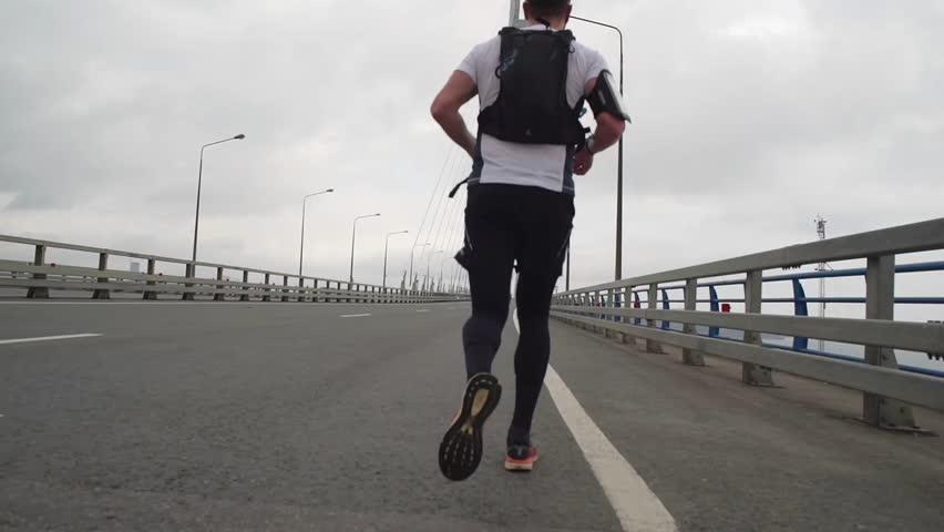athlete on marathon race running on a bridge. slow motion #20637037