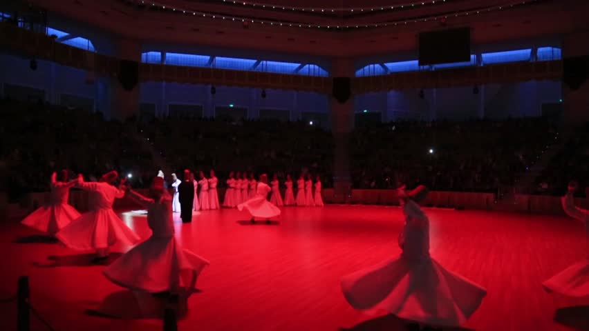 TURKEY-KONYA - JUL 29, 2016: Sufi whirling dervish (Semazen) dances at konya during holy month of Ramadan.Semazen conveys God's spiritual gift to those are witnessing ritual. He spins with the music.