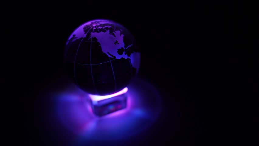 Sphere spins with world map on it and ring of color illumination color illumination box and sphere with world map on it spin on dark background hd sciox Choice Image