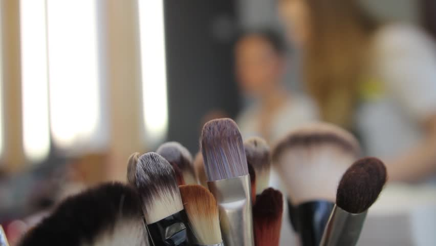 makeup tools photography. a professional make up artist gives woman suggestions on how to give herself makeup tools photography