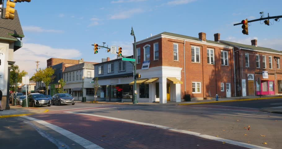 A daytime establishing shot of businesses on a typical Main Street in America. Pittsburgh suburb. Day/Night matching available.