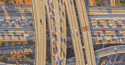 4K UHD vertical aerial top down view hyperlapse shot flying over heavy traffic on 10 freeway in Downtown, Los Angeles, California.