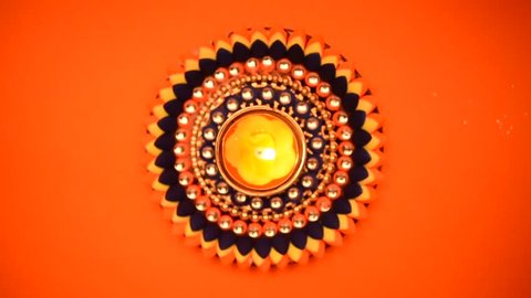 Decorative drawings called Rangoli designs around Diwali lamp during Diwali festival, Mumbai, Maharashtra, India, Southeast Asia.