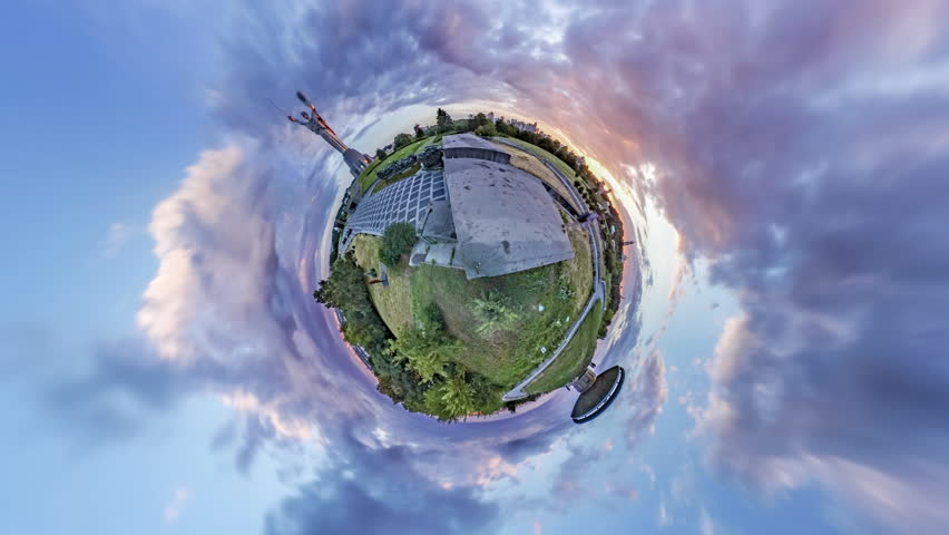 Tiny Little Planet 360 Degree Timelapse. on the Green Hills of the Museumof History of Ukraine in the 2Nd World War. Monument Motherland and Eternal Fire Bowl. Mini Planet, the Planet-City of Kyiv,