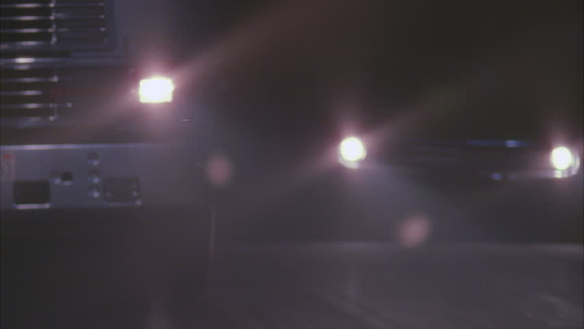 Night MPOV ing front semi truck light green classic muscle car Trans AM , car driving erratically next semi swerves comes stop, almost jack knives Rural road lined tall palms drunk driver, t | Shutterstock HD Video #20884417