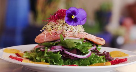 4K Close up rotating view of a beautiful healthy gourmet salmon salad