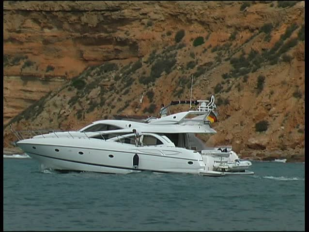 Motor yacht leaving harbor, clip 9