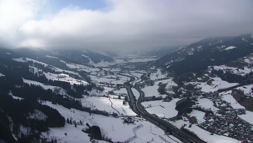 WS AERIAL Road and river in snow covered landscape of East Tyrol / Austria (February, 2016- Austria) | Shutterstock HD Video #20956387
