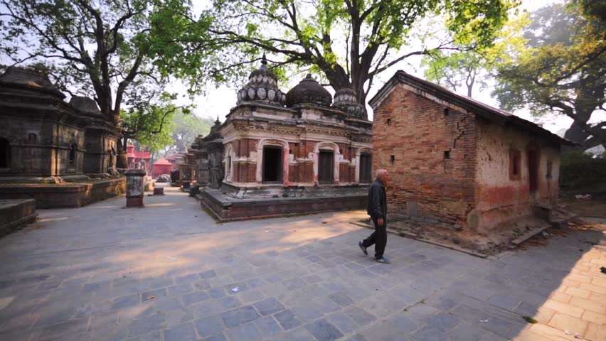 KATHMANDU, NEPAL - APRIL 11, 2016: Panoramic view of the Pashupatinath Temple with small Shiva temples with lingams. Complex is on UNESCO World Heritage Sites's list since 1979