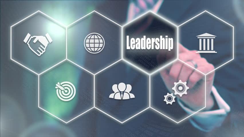 Businessman pressing a Business Leadership concept