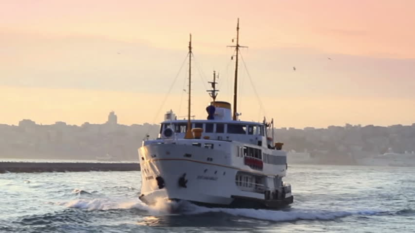 Passenger ship sails by the sunset in Istanbul