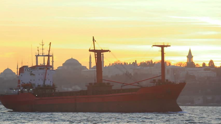Cargo ship sails on sunset in Istanbul
