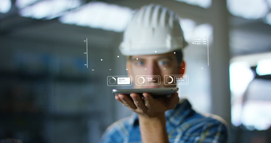 A worker uses a future technology platform to verify the design in holography and augmented virtual reality. Concept: future technology, multimedia technology, futuristic engineering. | Shutterstock HD Video #20989327