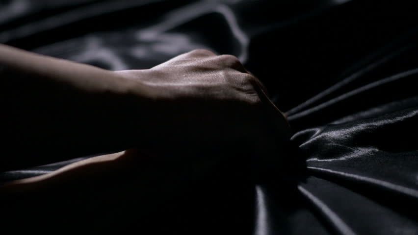 Making Love. Close-up of a man holding a woman's arms down in bed | Shutterstock HD Video #21012373