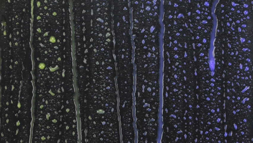 Beautiful background. Blue and yellow drops of rain on a black background.   Shutterstock HD Video #21076177