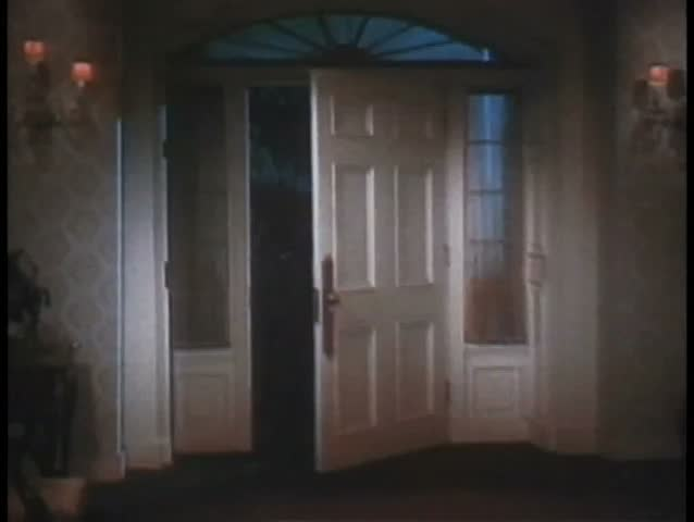 Wide Shot Of Front Door Opening By Itself