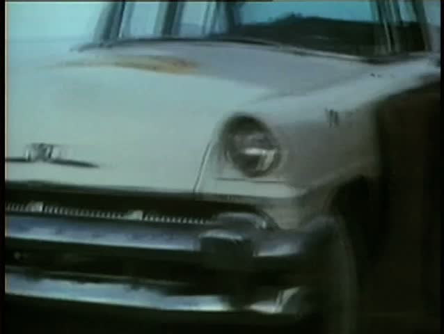 1970s car falling down slope and smashing