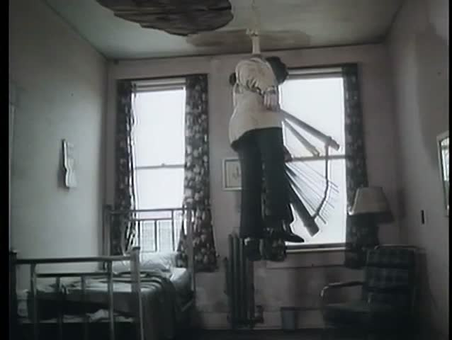 Dead man hanging from ceiling