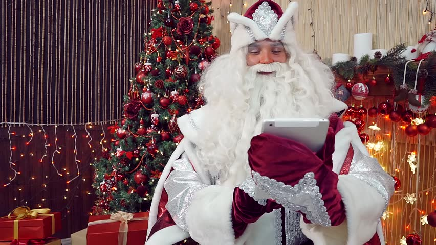 santa waking up from a short slumber and writing a letter stock