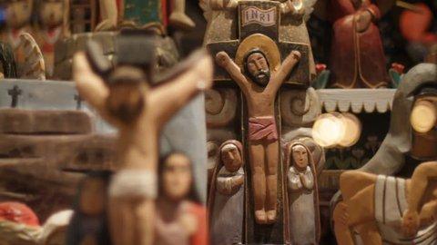 Wooden Jesus figures at store display