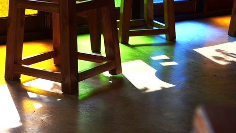 traditional Asian stain glass and wood style. Abstract background of colorful light reflected on floor