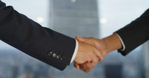 4k, Closeup shot of a two business people shaking hands. Slow motion.