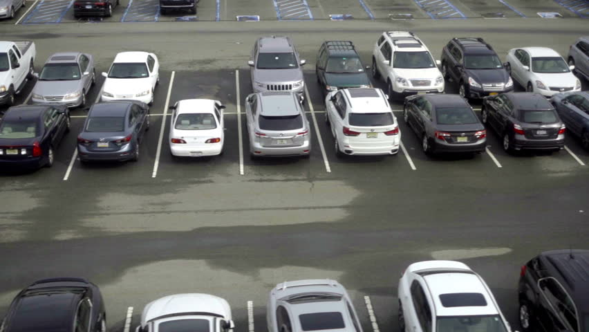 NEW YORK - SEPTEMBER 29, 2016: Tracking Past Parked Cars In Outdoor Parking Lot outside JFK Airport in NY.