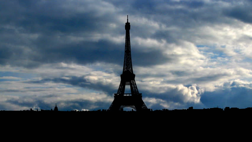 The Eiffel Tower is the most recognizable landmark of Paris, France. Built in 1889 as the entrance arch to the 1889 World's Fair it have become the world known attraction.    | Shutterstock HD Video #2124086