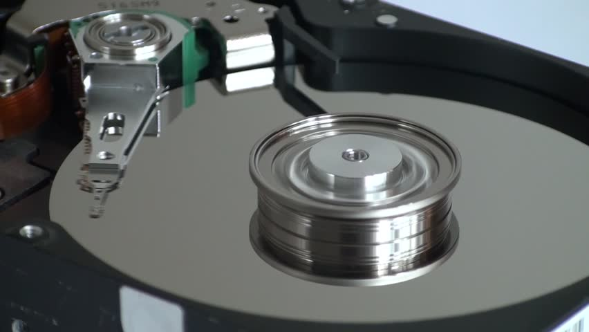 Metal circle plate and magnetic head inside hard disk drive reading and writing data | Shutterstock HD Video #21255607