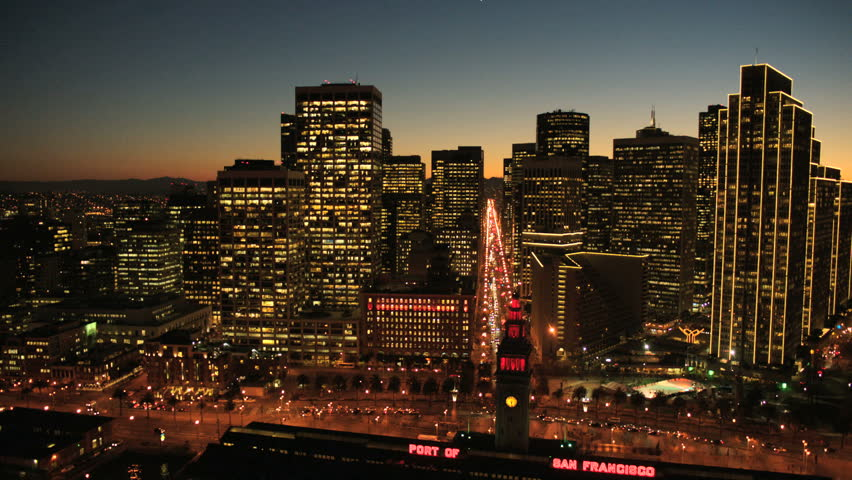 Aerial sunset low angled illuminated street view with San Francisco city skyscrapers, North America, USA