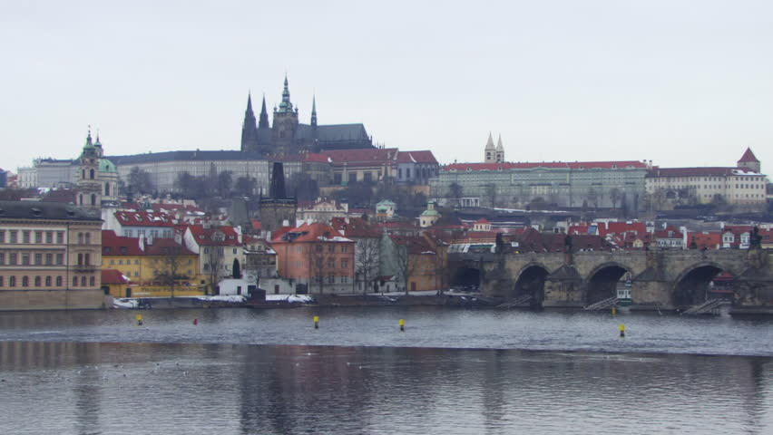 WIDE SHOT, Time lapse, Boats on river near Old Town Bridge in Prague, Czech Republic