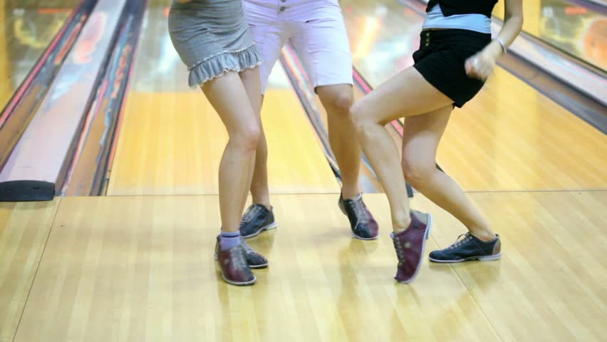 Legs of two girls and one guy dance in bowling shoes | Shutterstock HD Video #2135417
