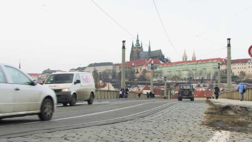 WIDE SHOT Tram over bridge Prague, Czech Republic