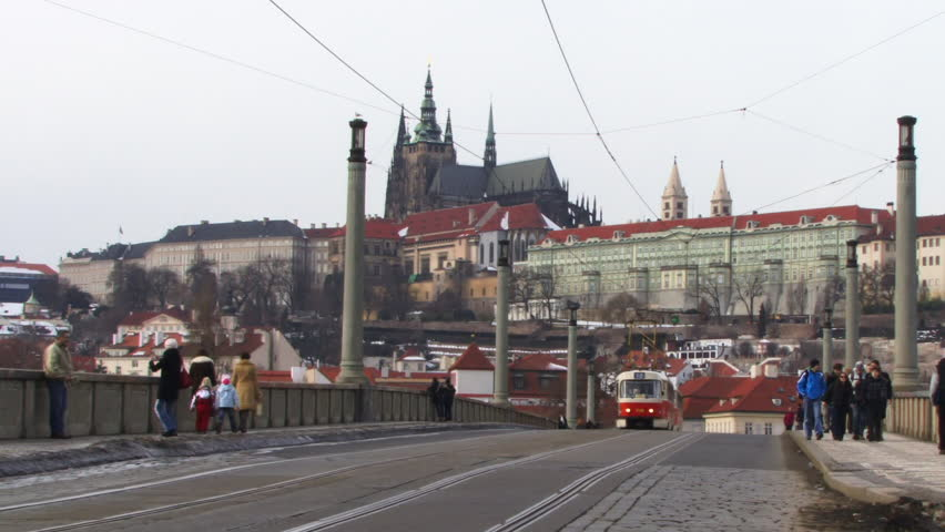 WIDE SHOT, Tram over bridge with St Vitus's Cathedral Prague, Czech Republic