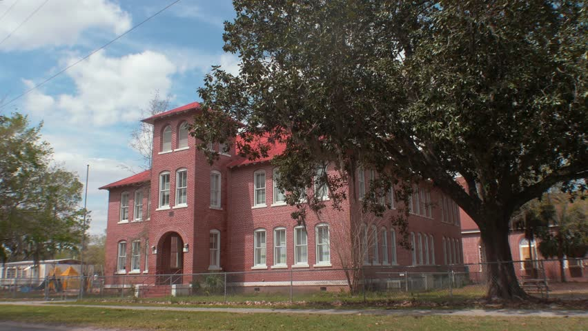 Old Brick School Building with Playground and School Buses, 4K #21358840