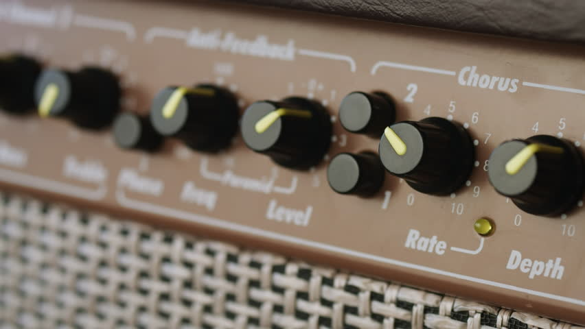 Switching on old style acoustic guitar amplifier