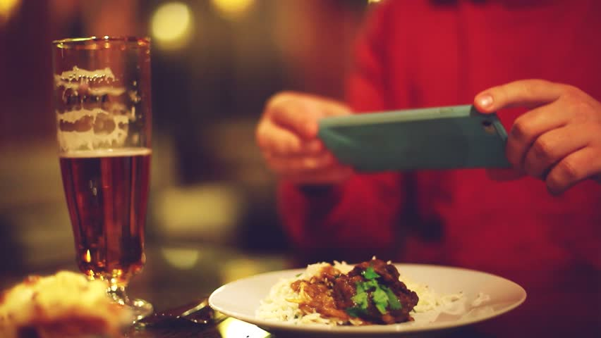 Close up of hands with smartphone taking a pic of food for social network site at bar or pub. 1920x1080 #21388672