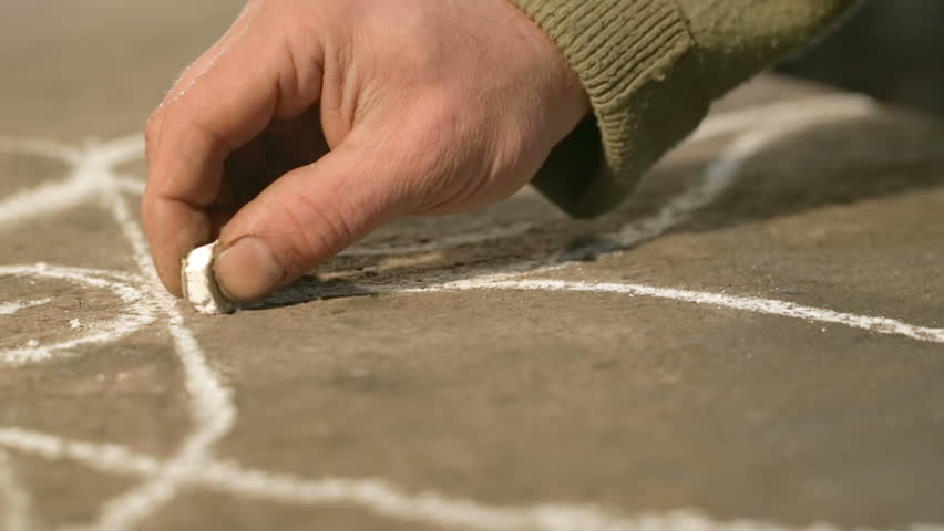 Close-up hand of a young blacksmith who draws a chalk sketch on the table | Shutterstock HD Video #21392038