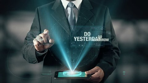 Businessman with Success concept choose Do Today from Do Yesterday Do Tomorrow using digital tablet