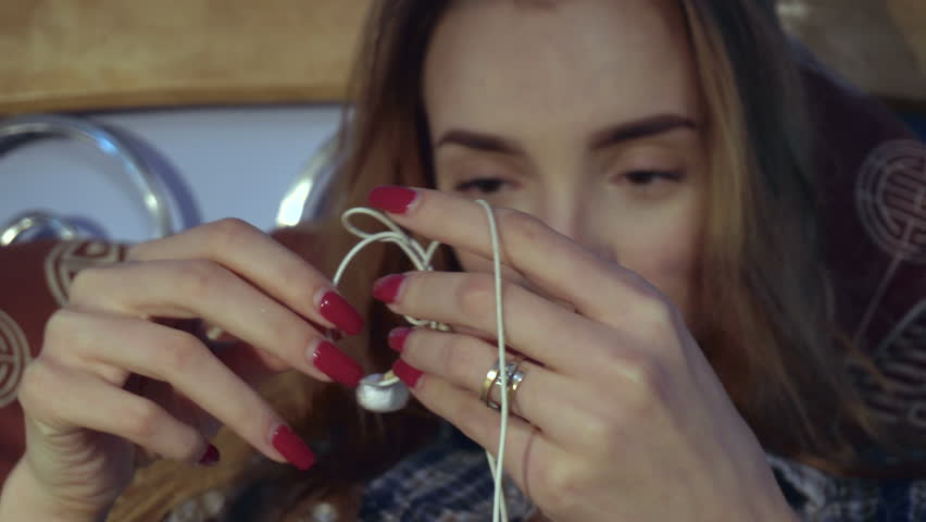 Girl unravels headphones | Shutterstock HD Video #21443617